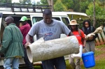 Ade Akinsiku transports a 200-pound biosand filter to the Siwo Clinic