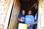 EWB-HU Team Lead Aleah Holt and Ade Akinsiku show Lucy  Kosgei how remove sand residue from the filter.