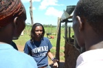 EWB-HU Team Lead Aleah Holt educates Lucy and Elphas Kosgei about safe rainwater harvesting