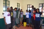 Members of EWB-HU and community engineers installed six biosand filters. The team also created a plastic biosand filter (center) using locally available materials. It is a low-cost alternative to the concrete biosand filter.